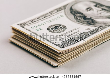 Money in dollars closeup, one hundred dollars banknotes