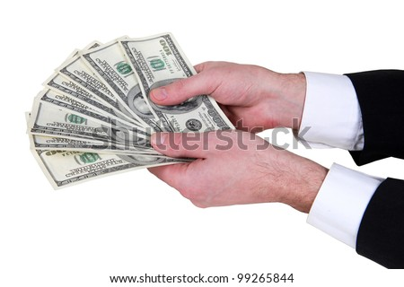 money in dollars in a man's hand - stock photo