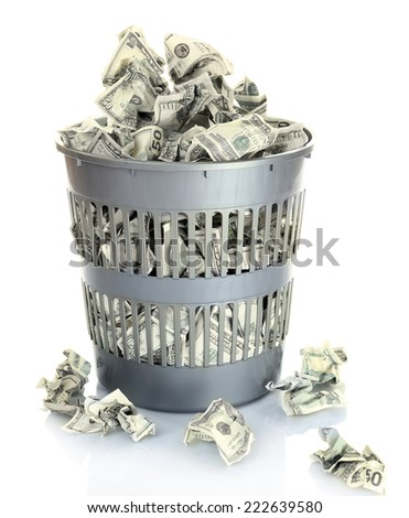 Money in dustbin isolated on white - stock photo