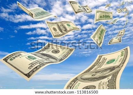 Money in flying in the sky. - stock photo