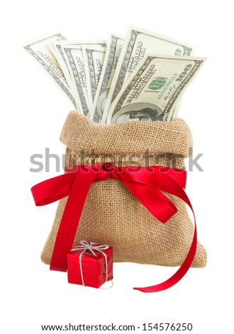 money in gift bag with red bow  isolated on white background - stock photo
