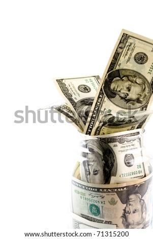 money in glass jar closeup on white background - stock photo