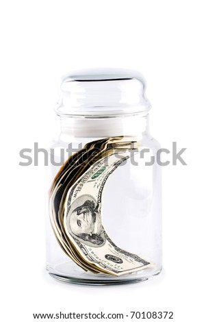 money in glass jar isolated on whiter background - stock photo