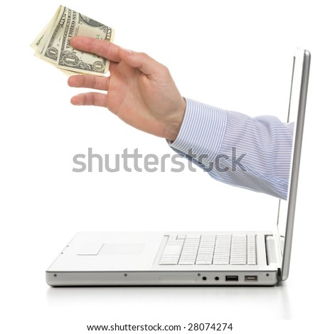 Money in hand from computer. Isolated on white.