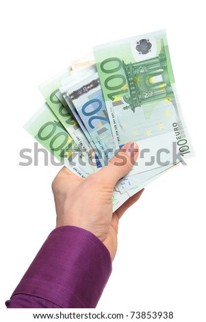 Money in hand isolated on white - stock photo