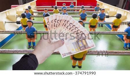 money in hand over texture  - stock photo