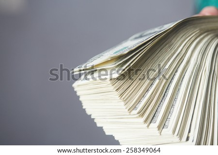 money in male hands - stock photo