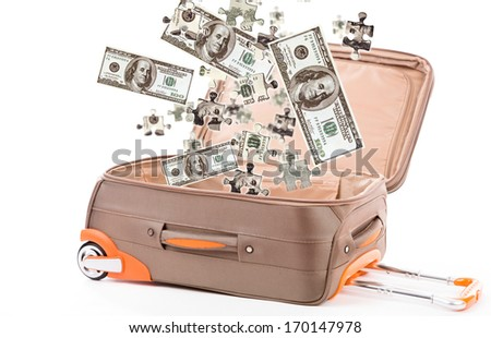 Money in suitcase isolated on white - stock photo