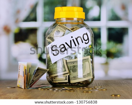 Money in the bank on room background - stock photo