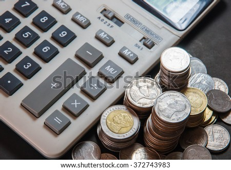 money in the form of  coins with calculator