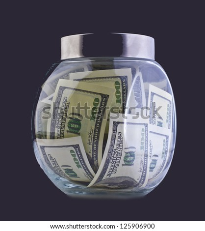 Money in the glass jar on black background     Idea black accounting