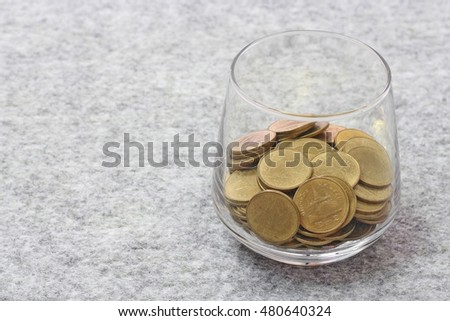 money in the glass on soft texture