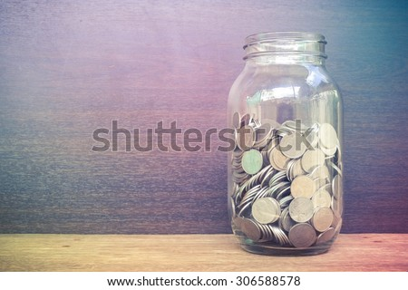 money in the glass with filter effect retro vintage style - stock photo