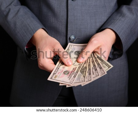 money in the hands of a businessman