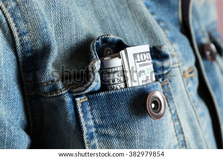 Money in the jeans jacket pocket, close up - stock photo