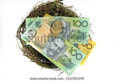 Money in the nest savings investment concept with Australian hundred and fifty dollar notes and one and two dollar coins, on white background. - stock photo