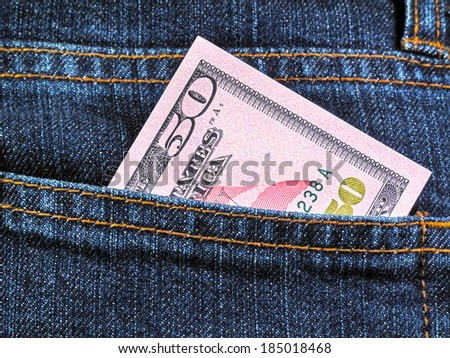 Money in the pocket of blue jeans  - stock photo