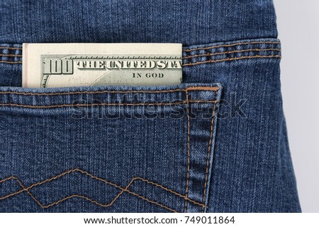 money in the pocket of blue jeans