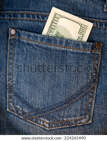Money in the pocket of jeans - stock photo