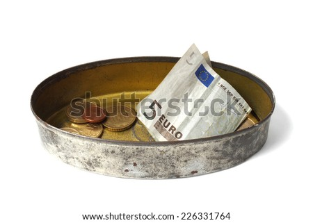 Money in tin can isolated on white background - stock photo