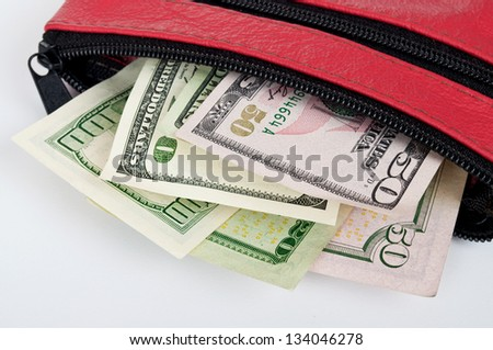 Money in wallet isolated on white background