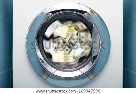 Money in washing machine - stock photo