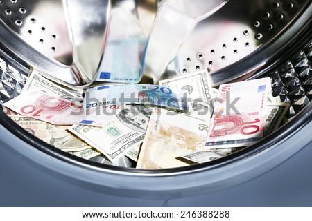Money in washing machine, closeup view - stock photo