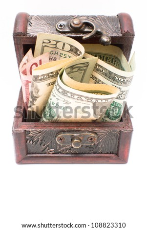Money in wooden chest on the white background , open box full with money - stock photo
