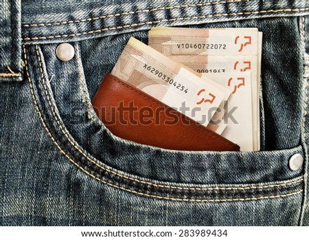 Money in your pocket in jeans. - stock photo