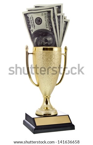 Money inside a golden winner cup isolated on white/Golden winner cup with money - stock photo