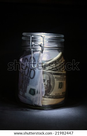 Money inside glassy pot