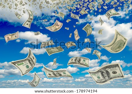 Money is flying in the blue sky. - stock photo