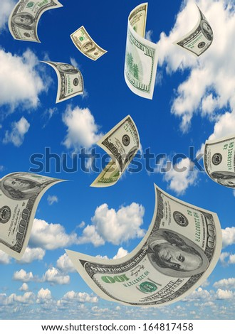 Money is flying in the sky. - stock photo