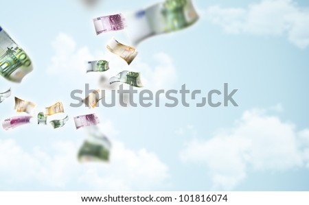 Money is flying into the camera - stock photo