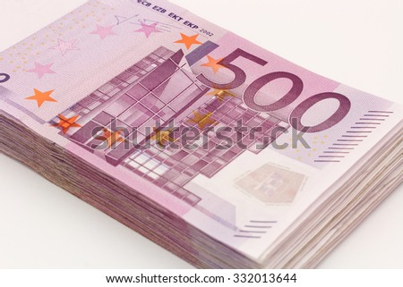 Money - Isolated stack of Five hundred (500) euro bills banknotes with white background - stock photo