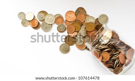 money jar emptied over white background - stock photo