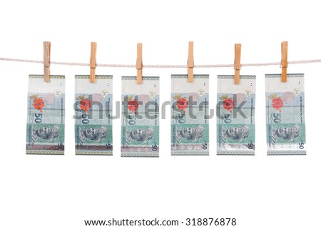 Money laundering concept with Ringgit Malaysia notes on clothesline in plain isolated white background. - stock photo