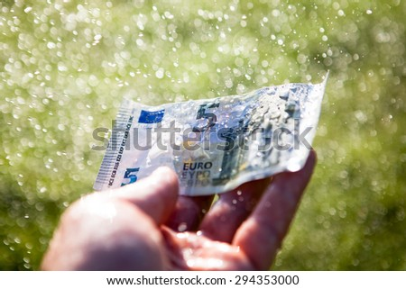 Money laundering in the rain - stock photo