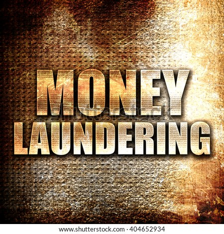 money laundering, written on vintage metal texture - stock photo