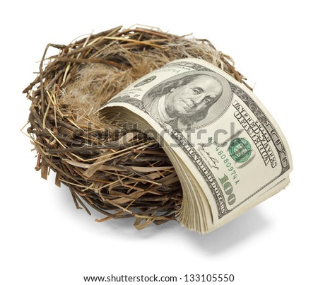 Money leaving the nest as if losing ones retirement. - stock photo