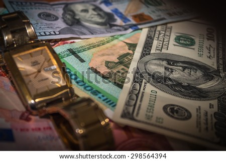 Money lie on the surface, currencies of different countries, one hundred dollars, euros, Russian rubles, Belorussian rubles, Belarus, clock, watch, time is money
