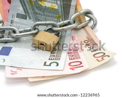 money locked by chain and padlock - stock photo