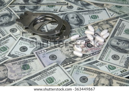 Money, loose pills and handcuffs