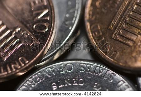 money macro photograph of pocket change focus near the center then blurring towards the edges - stock photo