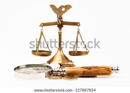 money , magnifying glass and scales of justice - stock photo