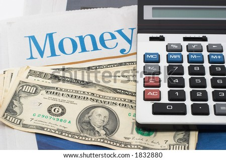 Money Market analysis, calculator, horizontal orientation. closeup, cash, headlines - stock photo