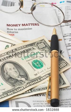 Money Market analysis, calculator, horizontal orientation. closeup, cash, headlines, glasses - stock photo