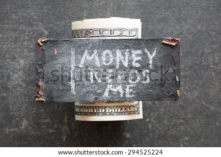 Money needs me concept. The inscription in chalk and dollars.