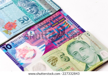 Money of Asia are Singapore, Malaysia and Hongkong on the white background, close up
