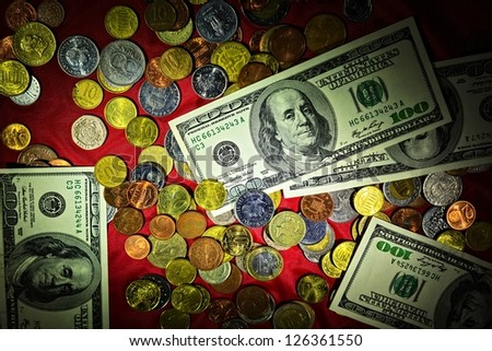 Money of the different countries on red background - stock photo